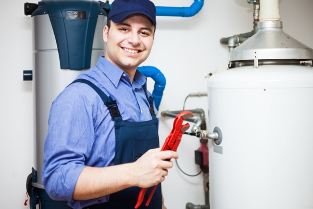 Tomball Water Heater Repair - plumbing technician repairing a water heater.